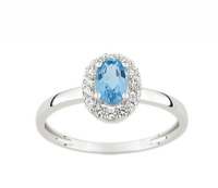 Bague Or 9 carats Entourage Topaze bleue